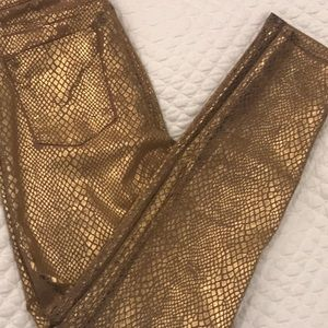 Gold painted jeans.